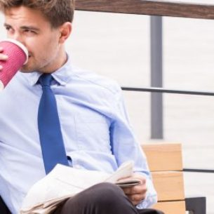 Businessman is drinking coffee
