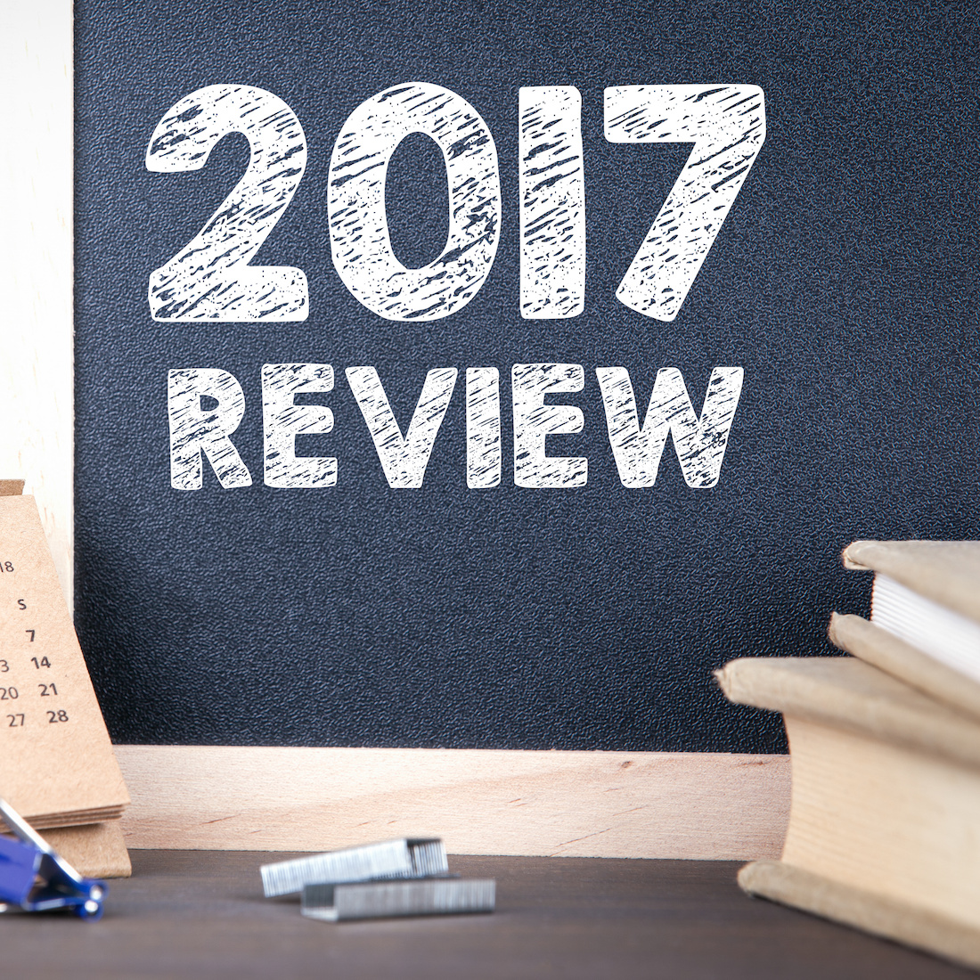 2017 review. paper calendar and chalkboard on a wooden table